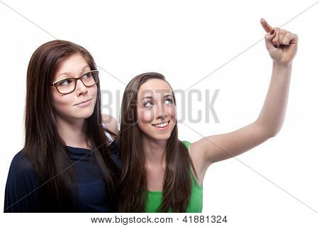 Woman Looking At Other Woman Pointing Finger On White Background