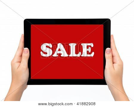 Female Hands Holding A Tablet Touch Computer Pad Gadget With Sale On A Screen