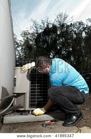 Hispanic Air Conditioning System Repair Maintenance Man