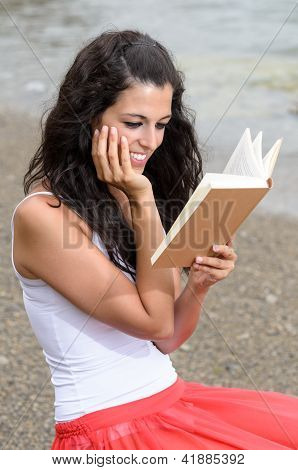 Dreamy Girl Reading Book At Beach