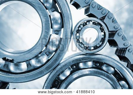 ball bearings, pinion-gears set against titanium, blue toning idea