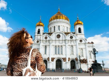 Woman tourist visit the Cathedral of Christ the Savior in Moscow, Russia