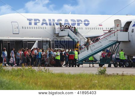 MOSCOW - SEP 01 : Passengers at boarding to plane of Transaero airline, Sep 01, 2011, Moscow, Russia. Company Transaero was created in december 1990, and official birthday is November 5 in 1991.