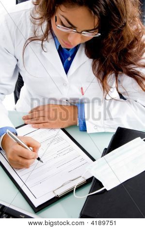 High Angle View Of Young Doctor Writing Prescription