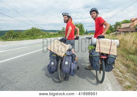MOSTAR, BOSNIA - AUGUST 14: Young cyclists touring from Madrid to Istanbul on August 14, 2012 near Mostar, Bosnia. A growing number of eco-travellers tour by bike to lessen their carbon footprint.