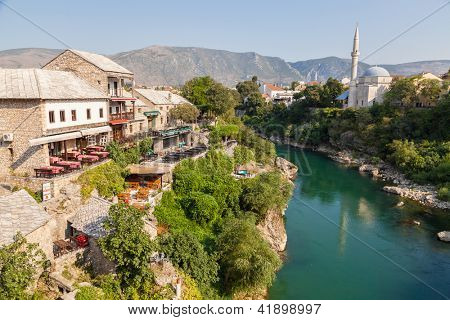 MOSTAR, BOSNIA - AUGUST 10: View of old town from Stari Most bridge on August 10, 2012 in Mostar, Bosnia. This old town founded in 1452, was mostly destroyed during the Bosnian war from 1991 to 1995.