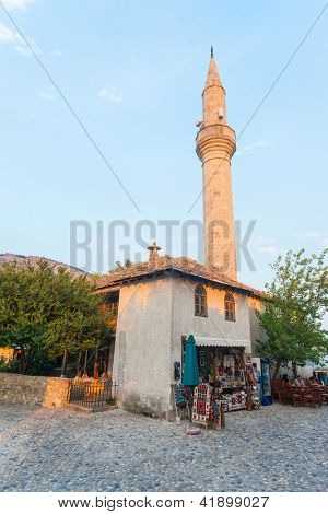 MOSTAR, BOSNIA - AUGUST 9: Small souvenir shop with minaret in background on August 9, 2012 in Mostar, Bosnia. The old town of Mostar, once a warzone, has blossomed into a beautiful tourist area.