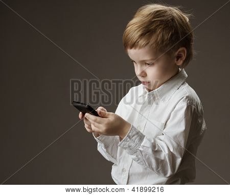 Boy Playing Game On Cell Phone. Kid Holding Mobile