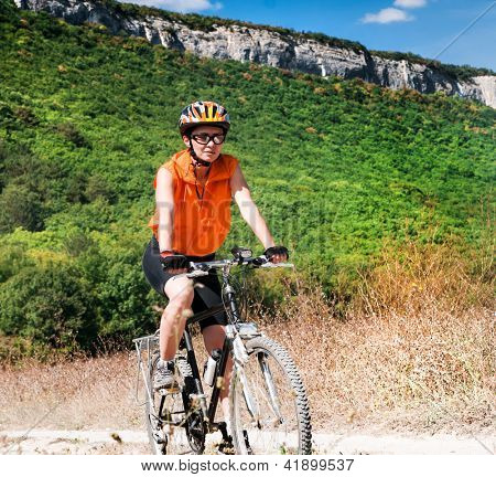 Mountain Biker and mountain background