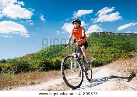 A young female riding a mountain bike outdoor