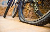 stock photo of legs air  - Two bicycles at the yard - JPG