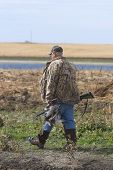 stock photo of pintail  - Man out hunting in the fall in North Dakota - JPG