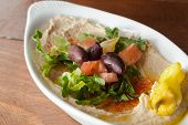 Hummus, olive oil, pita and salad