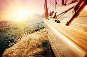 picture of yacht  - Yacht Sailing against sunset - JPG