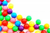 picture of gumballs  - Corner border of colorful gumball candies over white - JPG