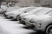 stock photo of slippery-roads  - Cars are under snow during a snowfall - JPG