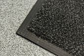 stock photo of nylons  - Industrial mats often rented to keep dust levels down in commercial business buildings warehouses or anywhere with polished plastic or sealed floors - JPG