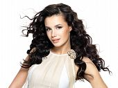 image of voluptuous  - Beautiful brunette woman with beauty long curly hair - JPG