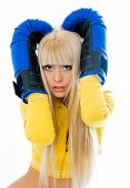 stock photo of boxing gloves  - scared young blond woman wearing boxing gloves isolated against white background - JPG