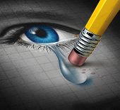 picture of trauma  - Depression Relief and conquering mental adversity with a pencil eraser removing a tear drop from a close up of a human face and eye as a concept of emotional support and therapy - JPG