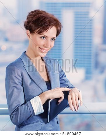 Closeup portrait of businesswoman waiting for someone, attractive female wearing elegant suit on cityscape background, success conception