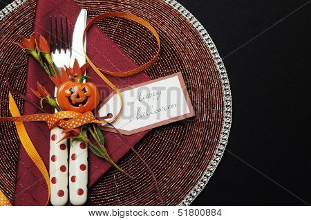 Happy Halloween Table Place Setting With Red Polka Dot Cutlery And Pumpkin Decorations.