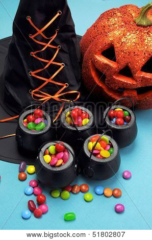 Halloween Black Witch Hat And Cauldrons Full Of Candy With Pumpkin Jack O Lantern For Trick Or Treat