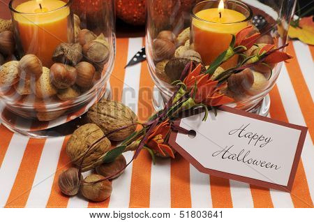 Happy Halloween Tag Message With Orange Candles And Nuts Centerpieces With Pumpkin Jack O Lantern De