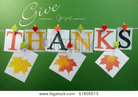 Give Thanks Message Spelling In Letters Hanging From Pegs On A Line For Thanksgiving Greeting In Aut