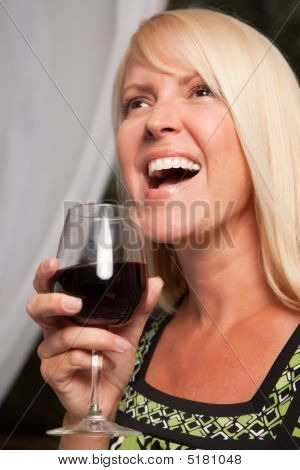 Beautiful Blonde Enjoying Wine