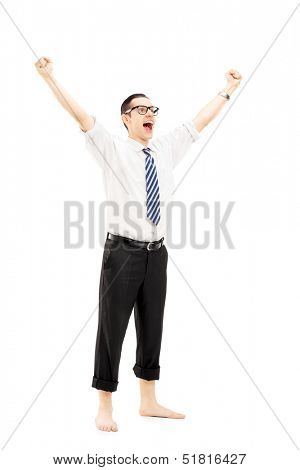 Full length portrait of an excited barefooted guy with raised hands gesturing happiness isolated on white background