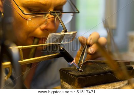 The Goldsmith Solder A Pin On An Earring