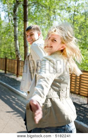 Young Couple Escaping And Smiling