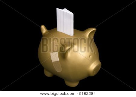 Gold Piggy Bank With Blank Paper