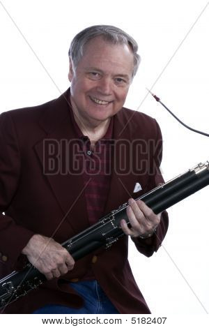 Senior Man Bassoon Musician On White