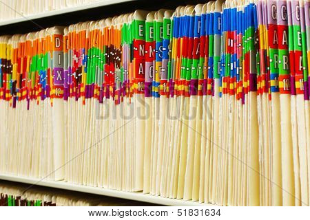 Rows of medical files with colorful tabs