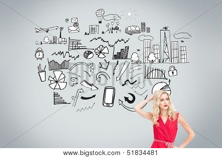 Composite image of thoughtful woman in red dress posing with a hand in her hair in front of economic illustrations on grey background