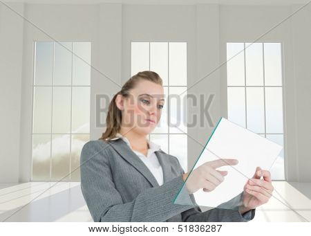Composite image of woman pressing something on the pane in bright 3d room with windows