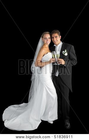 Content young couple posing holding champagne glasses smiling at camera