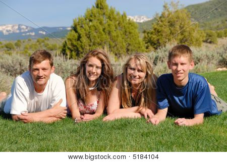 Family On Grass Area