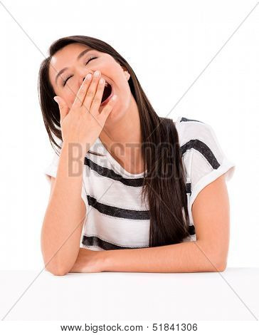 Lazy woman yawning - isolated over a white background