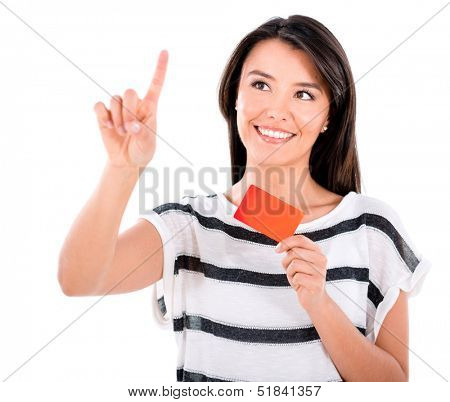 Woman with a debit card clicking - isolated over a white background