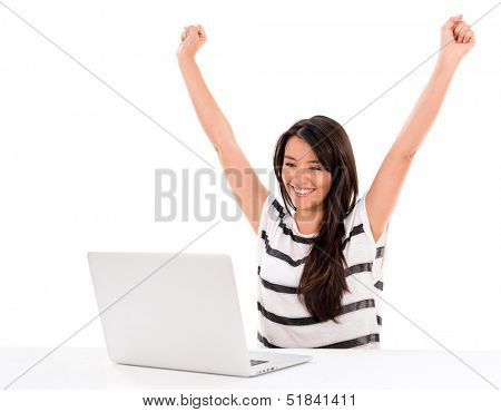 Successful woman working online with arms up - isolated over white