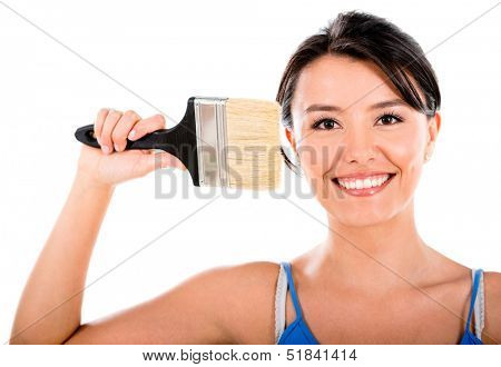 Happy woman painting with a brush - isolated over a white background