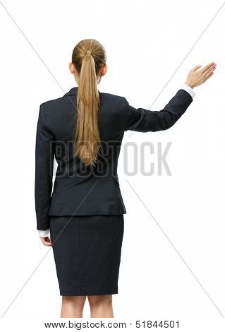 Backview of business woman waving her hand, isolated on white. Concept of leadership and success