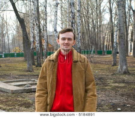 Young Men Against Spring Landscape