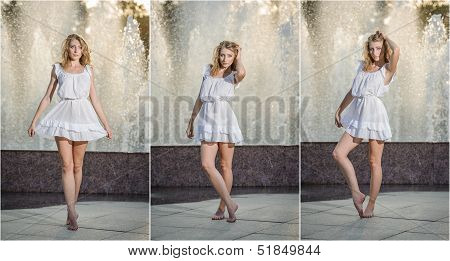Attractive girl in white short dress sitting in front of a fountain in the summer hottest day