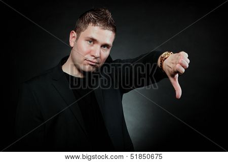 Disappointed Man Signaling Thumb Down
