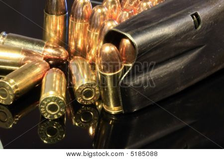 Various 9Mm Bullets And Magazine