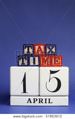 April 15 Calendar Date With Tax Time Message On Building Blocks For Tax Day Reminder. Vertical With